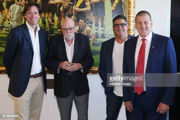 Journalist Patrick Smith poses with AFL CEO Gillon McLachlan and former AFL CEO Andrew Demetriou and incoming Hawks President Jeff Kennett during his...