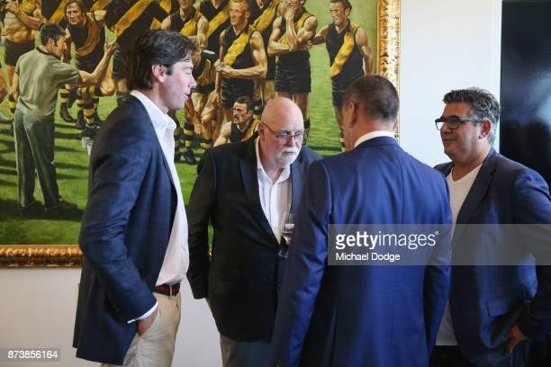 Journalist Patrick Smith talks with AFL CEO Gillon McLachlan and former AFL CEO Andrew Demetriou and incoming Hawks President Jeff Kennett during his...
