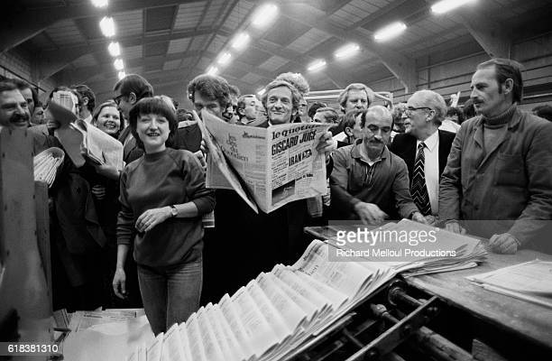 Journalist Philippe Tesson celebrates with contributors and friends as the first copies of a new edition of Le Quotidien de Paris newspaper rolls of...