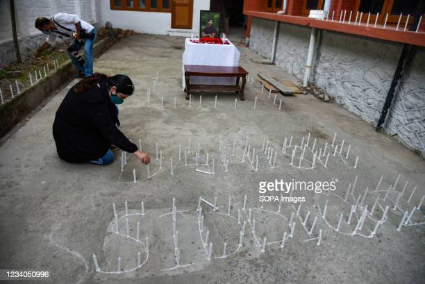 Journalist places candles in tribute to Danish Siddiqui in Srinagar. Reuters journalist Danish Siddiqui was killed on Friday while covering a clash...