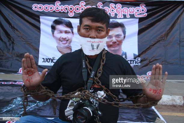 A journalist poses during a protest by local media to demand the release of Reuters journalists Wa Lone and Kyaw Soe Oo in Pyaye on December 27 2017...