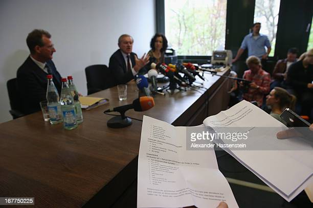 A journalist read the press statement of the Oberlandgericht Muenchen court during a press conference after the the lottery draw for the 50 media...