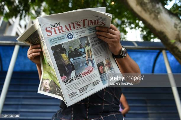 A journalist reads a newspaper with reports about the killed of North Korean man suspected to be Kim JongNam halfbrother of North Korean leader Kim...