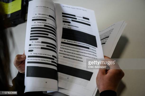 A journalist reads a redacted court filing from the Special Council Robert Mueller in the Paul Manafort case on April 16 2019 The final report from...
