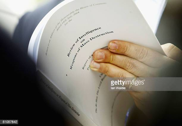 A journalist reads Lord Butler's report of intelligence into Weapons of Mass Destruction as it is released on July 14 2004 in London The report is...