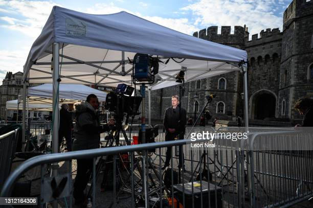 Journalist records a report from outside Windsor Castle, as tributes continue to be made to Prince Philip, the Duke Of Edinburgh who died at age 99...