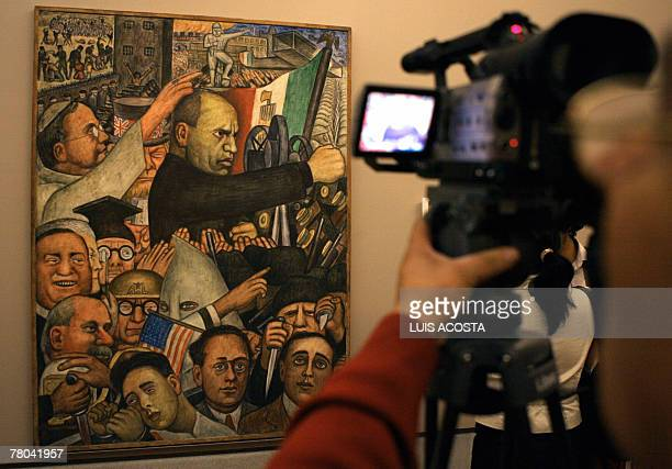 A journalist records the piece Number 17 which his one of the parts of the mural paint Mussolini created by Mexican artist Diego Rivera during a...