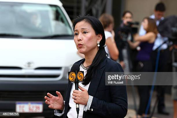 A journalist reports after attending a Chinese State Media Only briefing at the Consulate General Of The Peoples Republic of China in East Perth...