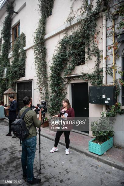 TV journalist reports from the crime scene in front of the sealed entrance of a home reportedly belonging to James Le Mesurier where his body was...