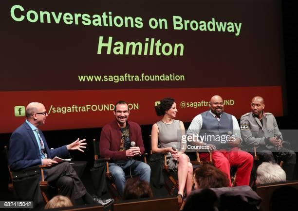 Journalist Richard Ridge moderates a panal with actors Javier Munoz Mandy Gonzalez James Monroe Iglehart and Brandon Victor Dixon during the SAGAFTRA...