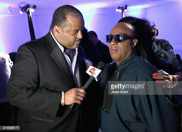 Journalist Roland Martin and musician Stevie Wonder attend the after party for the 45th NAACP Image Awards presented by TV One at Pasadena Civic...