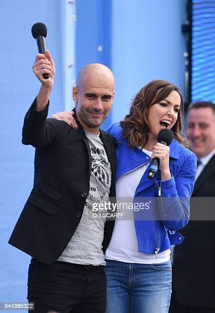 Journalist Sally Nugent hugs Spanish football manager Pep Guardiola after interviewing him as Guardiola is officially unveiled as the club's new...