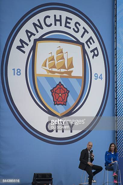Journalist Sally Nugent interviews Spanish football manager Pep Guardiola as he is officially unveiled as the club's new manager at the City Football...