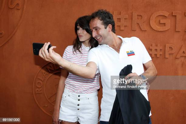 Journalist Sandrine Calvayrac and her companion TV Host Cyrille Eldin attend the 2017 French Tennis Open Day Six at Roland Garros at Roland Garros on...