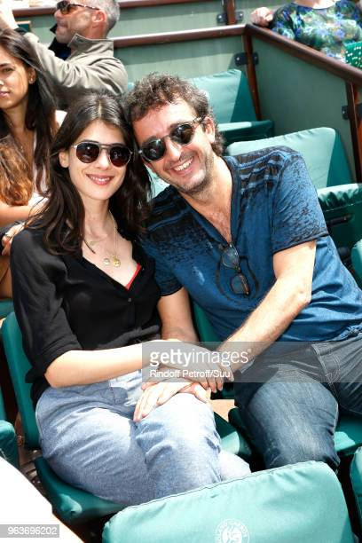 Journalist Sandrine Calvayrac and her companion TV Host Cyrille Eldin attend the 2018 French Open Day Four at Roland Garros on May 30 2018 in Paris...