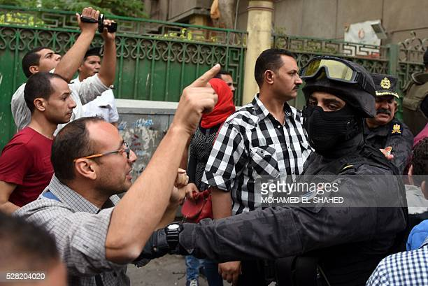A journalist scuffles with a policeman during a protest to demand the sacking of the interior minister on May 4 2016 outside the Journalists'...