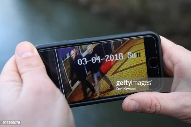A journalist shows CCTV footage on a mobile phone showing a man and woman who were later found unconscious on March 6 2018 in Salisbury England The...