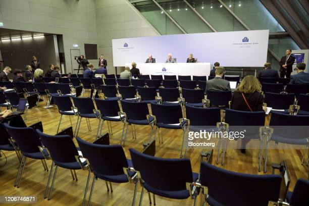 Journalist sit far apart separated by empty seats as Christine Lagarde president of the European Central Bank center speaks during the central bank's...