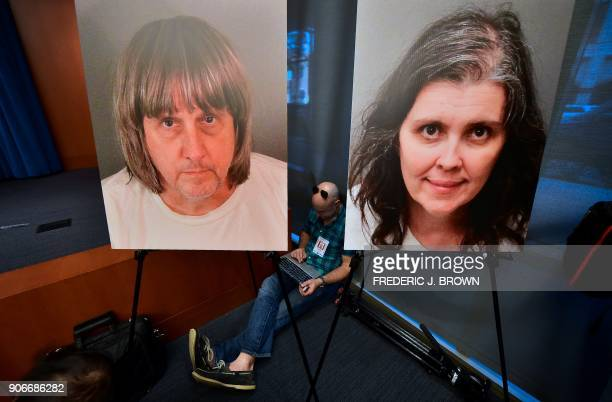 A journalist sits between portraits of David and Louise Turpin awaiting a press briefing in Riverside California on January 18 2018 David Allen...