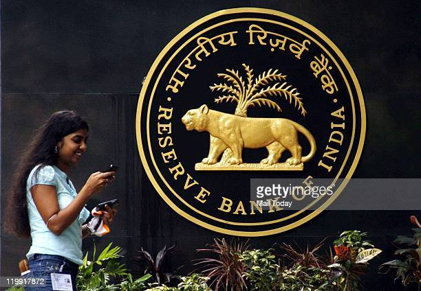 Journalist speaking on phone outside the building of Reserve Bank of India RBI Governor D Subbarao interacted with media after RBI's credit policy...
