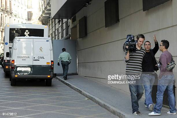 Journalist stand near a Police truck used to transport Argentinian born Dutch pilot Julio Alberto Poch to the high court in Madrid on October 6 2009...