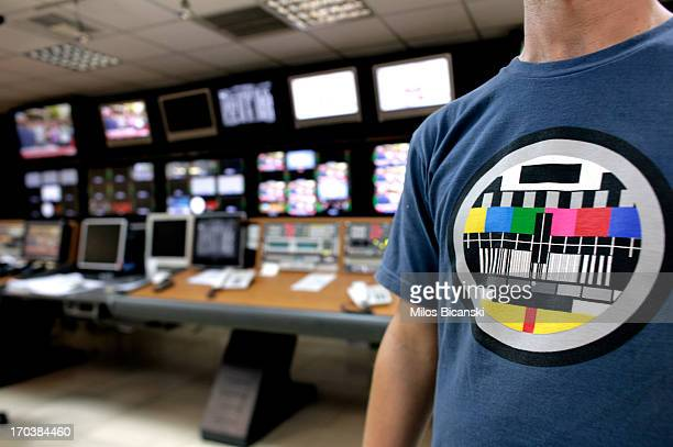 A journalist stands in a production suite within the headquarters of the Greek public broadcaster ERT on June 12 2013 in Athens Greece Journalists...