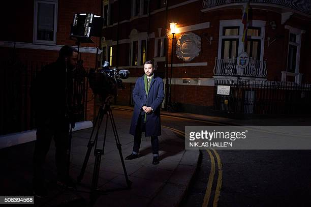 A journalist stands in front of the Ecuadorian embassy where WikiLeaks founder Julian Assange is holed up in London on February 4 2016 WikiLeaks...