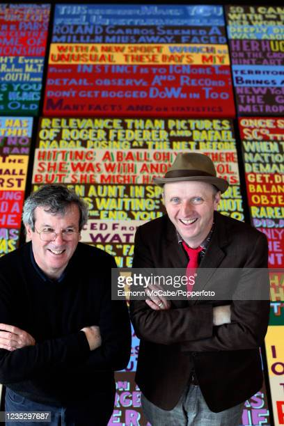 Journalist Steve Bierley and artist Bob and Roberta Smith in front of a piece of art made by Smith based on an article written by Bierley, circa...
