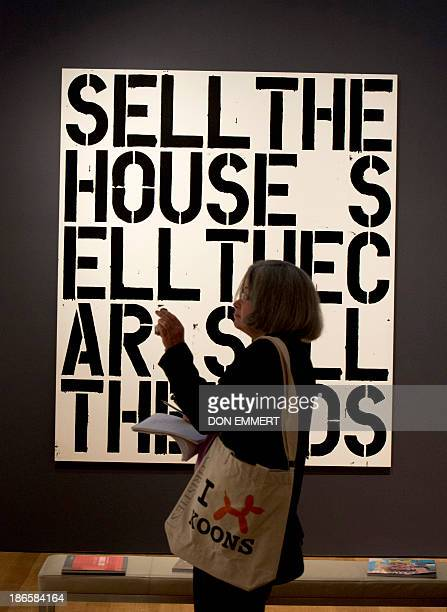 A journalist takes a photo in front of Christopher Wool's 'Apocalypse Now' October 31 2013 at Christie's in New York The alkyd and flashe on aluminum...