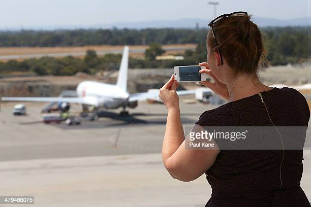 A journalist takes a photo on her smartphone of the Aeronexus Corporation's Boeing 767 used by the Rolling Stones at Perth international airport on...