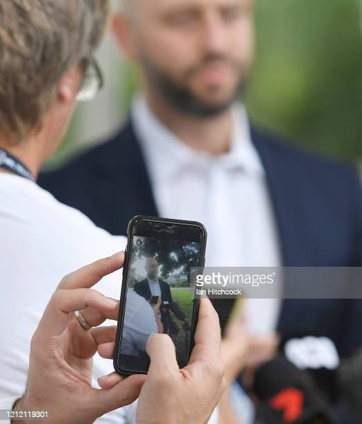 Journalist takes a picture of National Rugby League CEO Todd Greenberg during a media conference before the start of the round 1 NRL match between...