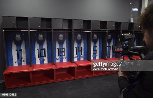 A journalist takes images in the locker room at Argentina's base camp in Bronnitsy south of Moscow on June 8 ahead of the Russia 2018 World Cup...