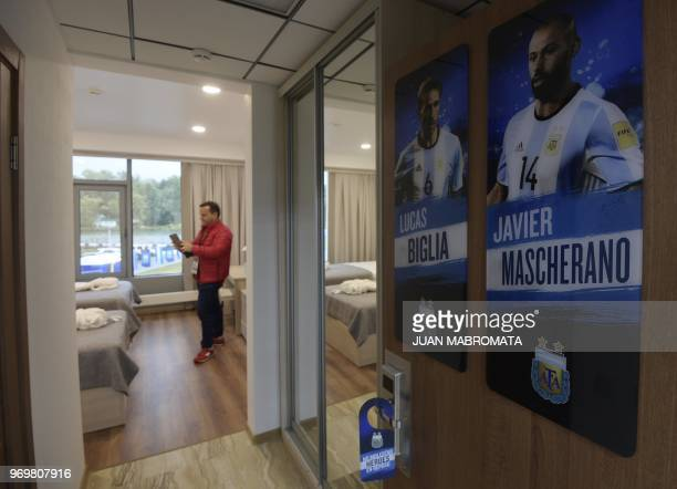 A journalist takes photographs inside of the Argentina's football players Javier Mascherano and Lucas Biglia' room at Argentina's base camp in...