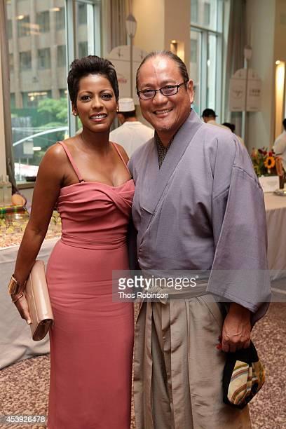 Journalist Tamron Hall and chef Masaharu Morimoto attend Taste Of Tennis Week Taste Of Tennis Gala at the W New York on August 21 2014 in New York...