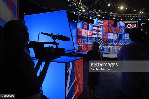 A journalist tapes the YouTubeCNN Presidential Debate stage on July 23 2007 in Charleston South Carolina The twohour broadcast featuring all eight...