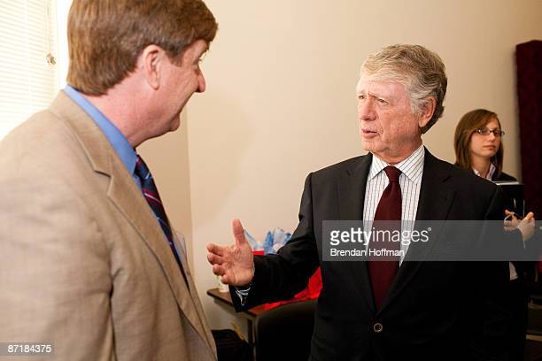 Journalist Ted Koppel speaks backstage with Rep Patrick Kennedy at a forum on HIV/AIDS on Capitol Hill on May 13 2009 in Washington DC The forum was...