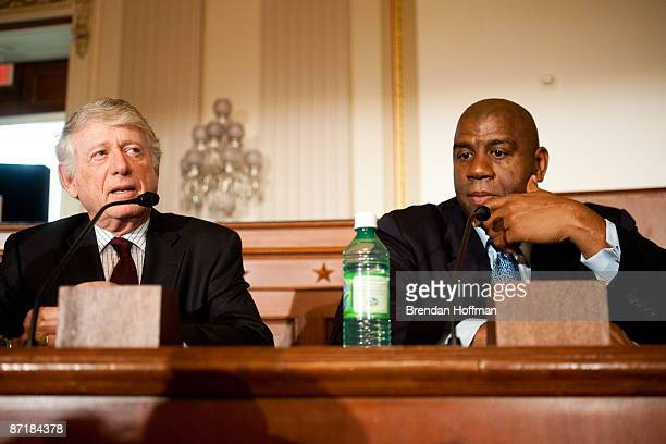 Journalist Ted Koppel speaks with former basketball player Earvin Magic Johnson at a forum on HIV/AIDS on Capitol Hill on May 13 2009 in Washington...