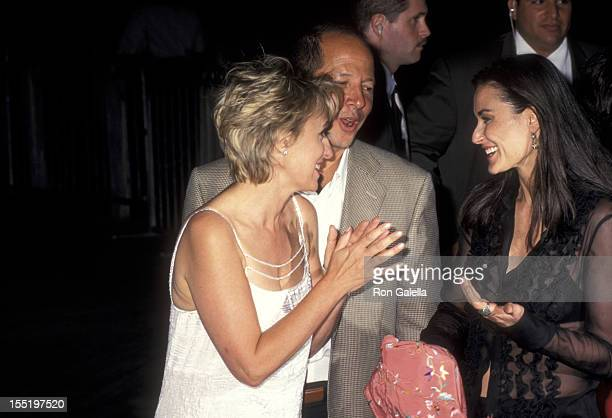Journalist Tina Brown Ron Galotti and Demi Moore attend the launch party for Talk Magazine on August 2 1999 at Liberty Island in New York City