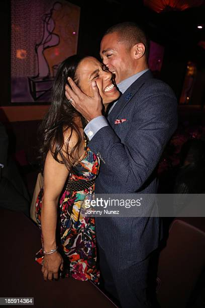 Journalist TJ Holmes and wife Marilee FiebigHolmes attend the 2013 Black Girls Rock Shot Caller Dinner at B Co on October 25 2013 in New York City