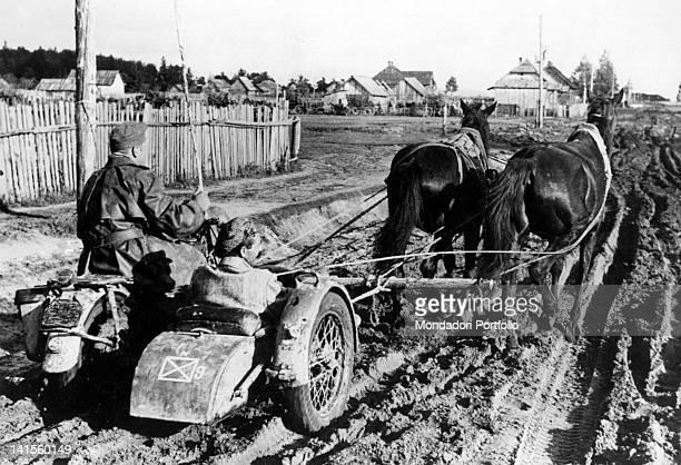 A journalist travels towards Kharkiv on a sidecar pulled through the mud by a pair of horses Ukraine October 1941