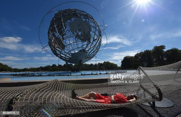 A journalist tries out an installation of Chinese Artist Ai Weiwei entitled 'Good Fences Make Good Neighbors' during a press preview at the Unisphere...