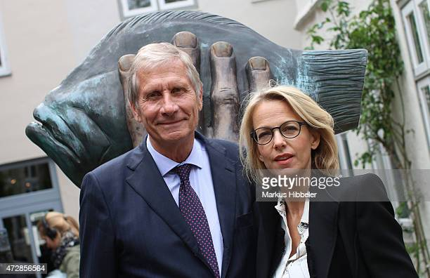 Journalist Ulrich Wickert and his wife Julia Jaekel attends a memorial service for the deceased author Guenter Grass on May 10 2015 in Luebeck...