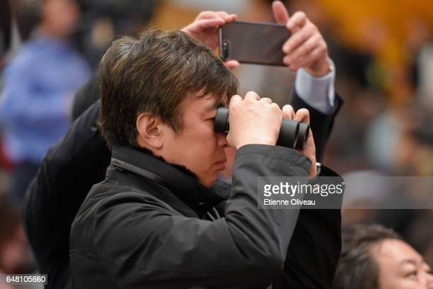A journalist uses googles during the opening session of the National People's Congress at The Great Hall of People on March 5 2017 in Beijing China