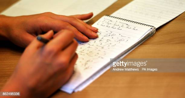A Journalist uses Shorthand to write on a notepad