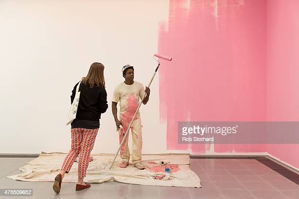 A journalist views Duane Hanson's 1984/1988 sculpture 'House Painter' during a press preview at the Serpentine Sackler Gallery on June 1 2015 in...