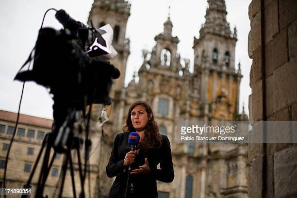 A journalist works at Plaza do Obradoiro in front of Santiago de Compostela Cathedral where a memorial mass will be held on July 29 2013 in Santiago...