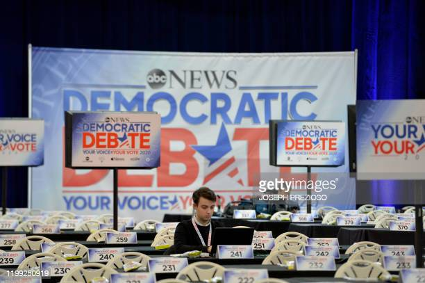 A journalist works on a laptop in the spin room before the start of the ABC Democratic Debate later in the evening at St Anselm College in Manchester...