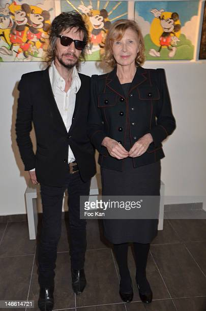 Journalist/musician Patrick Eudeline and actress Aurore Clement attend the Une Exposition Particuliere by Ettore Scola and Le Magicien d'Hollywood by...