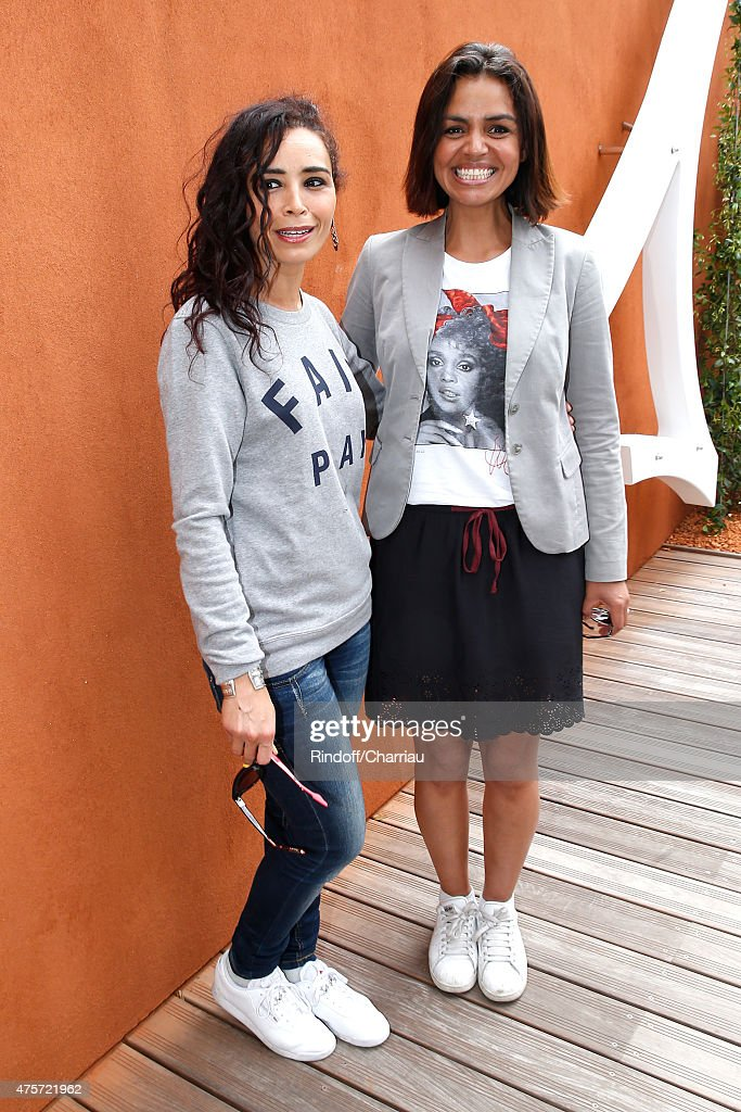 Journalists Aida Touihri and Laurence Roustandjee attend the 2015 Roland Garros French Tennis Open - Day Eleven, on June 3, 2015 in Paris, France.