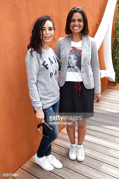 Journalists Aida Touihri and Laurence Roustandjee attend the 2015 Roland Garros French Tennis Open Day Eleven on June 3 2015 in Paris France